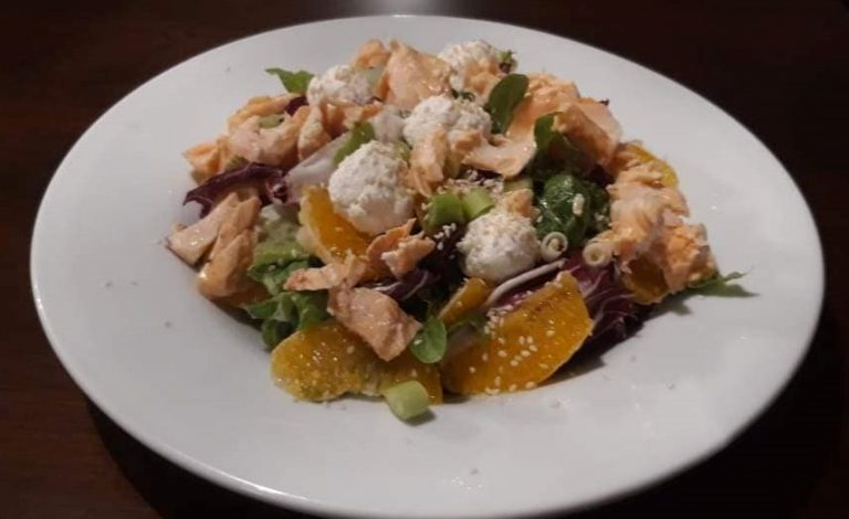 Salmon salad with fresh orange  and goat cheese