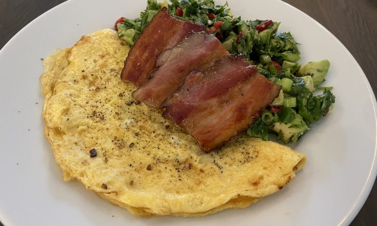 Easy omelet with bacon and avocado salad